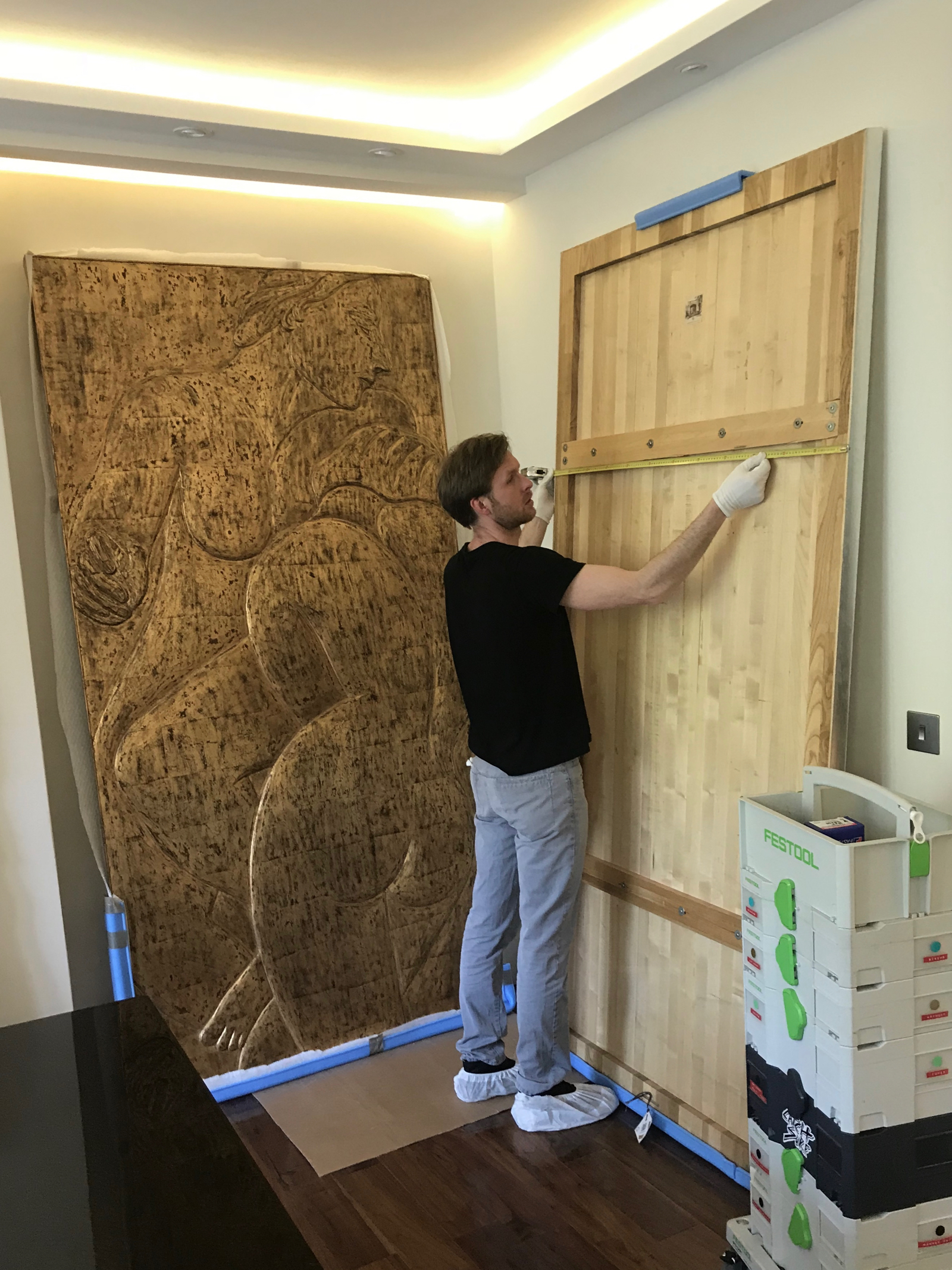 Hanging heavyweight artworks using split battens Maida Vale London